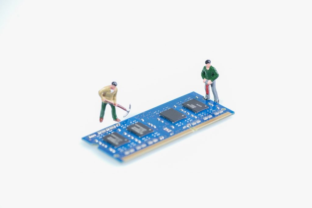 Miniature workmen working on the computer RAM