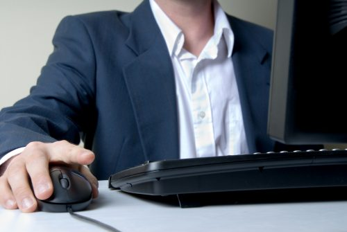 Man Searching With Mouse In Silence
